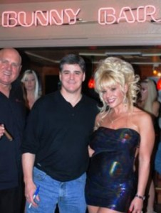 From left to right: PIMP (Bunny brothel owner Dennis Hof), JOHN (Sean Hannity with pen), and HOOKER (Stacy Swallows Air Force Amy).