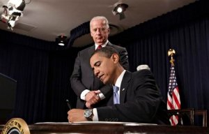 "THE BEGINNINGS  Jan.21- An unimpressed Biden looks on as Obama struggles to break the habit of writing in ""chicken scratch."""